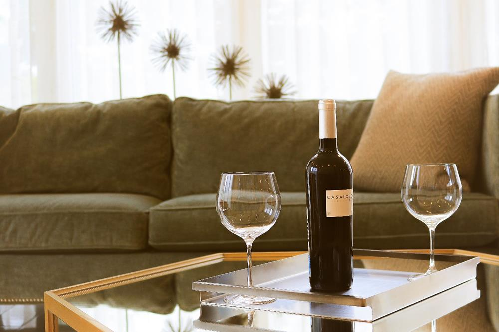 A glass of wine on a table  Description automatically generated